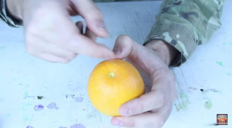 truco para pelar una naranja con las manos - 01